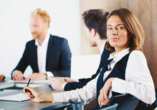 Confident businesswoman during a business meeting Stock Photos
