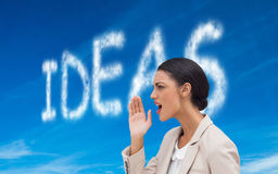 Confident businesswoman calling for someone Stock Image