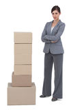 Confident businesswoman with cardboard boxes Stock Photos