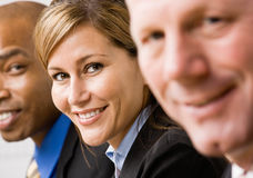 Confident businesswoman with co-workers Stock Photography