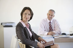 Confident Businesswoman With Colleague In Office Stock Image