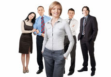 Confident businesswoman with colleagues Stock Photo