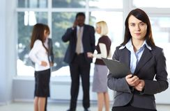 Confident businesswoman with colleagues Royalty Free Stock Images