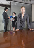 Confident businesswoman, colleagues in background Stock Image