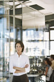 Confident Businesswoman With Colleagues In Background Royalty Free Stock Image