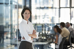 Confident Businesswoman With Colleagues In Background Stock Images