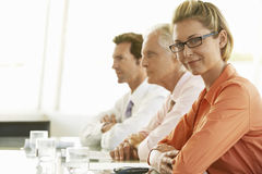 Confident Businesswoman With Colleagues In Conference Room Royalty Free Stock Photos
