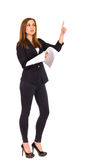 Confident businesswoman with documents directing. Confident businesswoman holding documents and directing. Full length studio shot isolated on white Royalty Free Stock Images