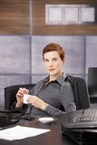 Confident businesswoman drinking coffee Stock Photos