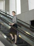 Confident Businesswoman On Escalator Stock Photography