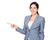 Confident businesswoman with finger indicate aside Royalty Free Stock Images