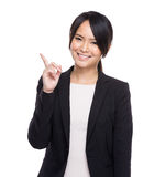 Confident businesswoman finger up Royalty Free Stock Images