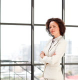 Confident businesswoman with folded arms Stock Photos