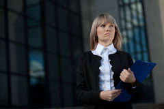 Confident businesswoman with folder Stock Image