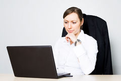 Confident businesswoman. In front of a computer stock images