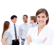 Confident businesswoman  in front of her team Stock Photos