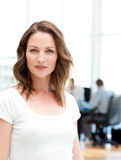 Confident businesswoman in front of her teamwork Stock Photography
