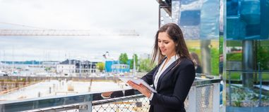 Confident businesswoman in front of modern office building. Business, banking, corporation and financial market concept. Confident businesswoman in front of royalty free stock photos