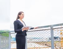 Confident businesswoman in front of modern office building. Business, banking, corporation and financial market concept. Confident businesswoman in front of royalty free stock photo