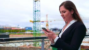 Confident businesswoman in front of modern office building. Business, banking, corporation, real estate and financial. Market concept stock video footage