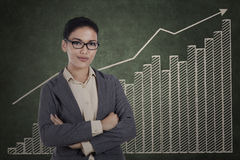 Confident businesswoman with growth graph Stock Images