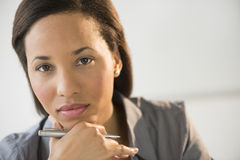 Confident Businesswoman With Hand On Chin Stock Images