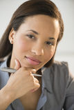 Confident Businesswoman With Hand On Chin Royalty Free Stock Photography