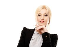 Confident businesswoman with hand on chin royalty free stock photos
