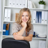 Confident Businesswoman With Hand On Chin Stock Photography