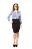 Confident businesswoman with hand on hip. Full length portrait of a confident businesswoman with hand on hip, isolated over white background Stock Photos