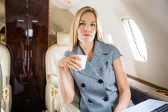Confident Businesswoman Having Coffee In Private Stock Image