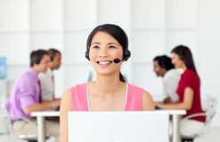 Confident Businesswoman with headset on. At work Stock Photo