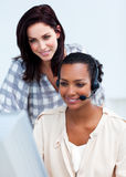 Confident businesswoman with headset on Royalty Free Stock Image