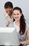 Confident businesswoman helping her colleague Royalty Free Stock Photos