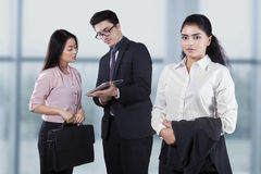 Confident businesswoman with her employees Royalty Free Stock Images