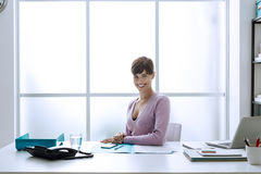 Confident businesswoman in her office Stock Photos
