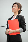 Confident Businesswoman Holding A Folder Stock Photography
