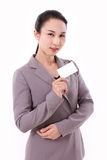 Confident businesswoman holding blank card Stock Photography