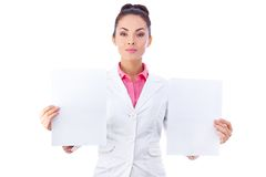 Confident businesswoman holding blank two Stock Photo