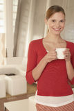 Confident Businesswoman Holding Coffee Cup In Office Lobby Royalty Free Stock Photos