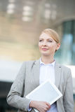 Confident businesswoman holding digital tablet outdoors Royalty Free Stock Photo