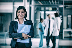 Confident businesswoman holding file Stock Images