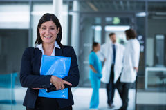 Confident businesswoman holding a file Stock Image