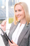 Confident businesswoman holding folder Royalty Free Stock Photos