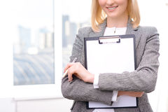 Confident businesswoman holding folder Stock Images