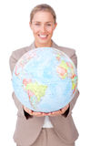 Confident businesswoman holding a globe Stock Photos