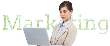 Confident businesswoman holding laptop Royalty Free Stock Photo