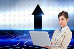 Confident businesswoman holding laptop Royalty Free Stock Photography