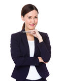 Confident Businesswoman holding a pen Royalty Free Stock Images