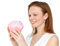Confident businesswoman holding a piggybank Stock Photo